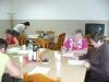 Uczestniczki warsztatów podczas pracy z materialami szkoleniowymi